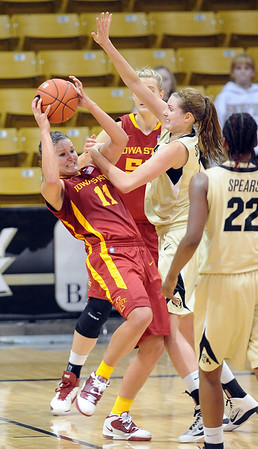 "Kelsey Bolte of ISU is pressured by Julie Seabrook  of CU on the last play of regulation.<br /> For more photos of the game, go to  <a href=""http://www.dailycamera.com"">http://www.dailycamera.com</a>.<br /> Cliff Grassmick / January 15, 2011"