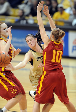 """Chelsea Dale of CU gets the out from Chelsea Poppens, left, and Lauren Mansfield, both of ISU.<br /> For more photos of the game, go to  <a href=""""http://www.dailycamera.com"""">http://www.dailycamera.com</a>.<br /> Cliff Grassmick / January 15, 2011"""