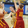 "Chelsea Dale of CU gets the out from Chelsea Poppens, left, and Lauren Mansfield, both of ISU.<br /> For more photos of the game, go to  <a href=""http://www.dailycamera.com"">http://www.dailycamera.com</a>.<br /> Cliff Grassmick / January 15, 2011"