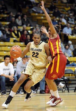 """Brittany Spears of Colorado drives around Chassidy Cole of ISU.<br /> For more photos of the game, go to  <a href=""""http://www.dailycamera.com"""">http://www.dailycamera.com</a>.<br /> Cliff Grassmick / January 15, 2011"""