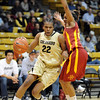 "Brittany Spears of Colorado drives around Chassidy Cole of ISU.<br /> For more photos of the game, go to  <a href=""http://www.dailycamera.com"">http://www.dailycamera.com</a>.<br /> Cliff Grassmick / January 15, 2011"