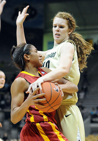 "Chassidy Cole, left, of ISU, and Rachel Hargis of CU, battle for the ball on Saturday.<br /> For more photos of the game, go to  <a href=""http://www.dailycamera.com"">http://www.dailycamera.com</a>.<br /> Cliff Grassmick / January 15, 2011"
