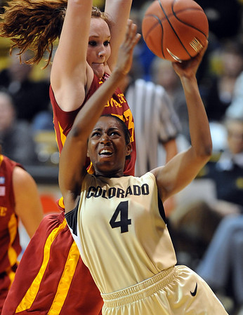 "Britney Blythe of CU drives under Chelsea Poppens of ISU.<br /> For more photos of the game, go to  <a href=""http://www.dailycamera.com"">http://www.dailycamera.com</a>.<br /> Cliff Grassmick / January 15, 2011"