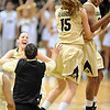 "Julie Seabrook (15) and Brittany Spears celebrate the overtime win with other CU teammates over Iowa State.<br /> For more photos of the game, go to  <a href=""http://www.dailycamera.com"">http://www.dailycamera.com</a>.<br /> Cliff Grassmick / January 15, 2011"