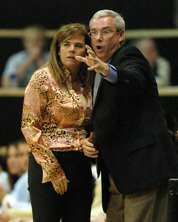 Colorado head coach  Kathy McConnell-Miller, listens to her assistant and brother, Tom McConnell, during the Iowa State game.<br /> Cliff Grassmick / January 16, 2010