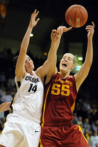 Megan Malcolm-Peck, left of CU, and Anna Prins of Iowa State, collide on a rebound. Prins played at Broomfield High last year. Cliff Grassmick / January 16, 2010