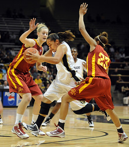 Bianca Smith of Colorado, center, drives between Anna Prins, left, and Chassidy Cole, both of Iowa State, during the first half of the January 16, 2010 game in Boulder. For more photos of the game, go to www.dailycamera.com. Cliff Grassmick / January 16, 2010