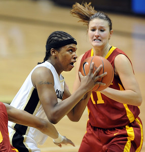 Brittany Spears of CU drives the lane past Kelsey Bolte of Iowa State on Saturday. For more photos of the game, go to www.dailycamera.com. Cliff Grassmick / January 16, 2010