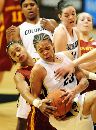 """Denae Stuckey, left, of ISU, and Chucky Jeffery of CU battle for a rebound late in the game.<br /> For more photos of the game, go to  <a href=""""http://www.dailycamera.com"""">http://www.dailycamera.com</a>.<br /> Cliff Grassmick / January 16, 2010"""