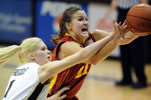 Alyssa Fressle of CU knocks the ball away from Kelsey Bolte of ISU.<br /> <br /> Cliff Grassmick / January 16, 2010