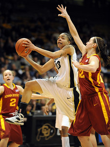 Chucky Jeffery of Colorado drives around Jessica Schroll of Iowa State during the first half of the January 16, 2010 game in Boulder. For more photos of the game, go to www.dailycamera.com. Cliff Grassmick / January 16, 2010