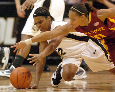 Brittany Spears, left, of CU gets Denae Stuckey of Iowa State. For more photos of the game, go to www.dailycamera.com. Cliff Grassmick / January 16, 2010