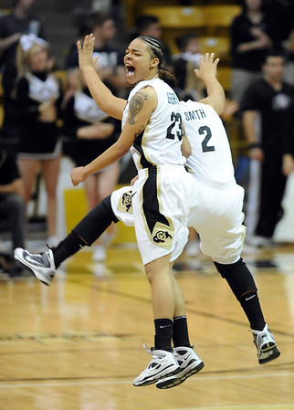 "Chucky Jeffery, left, and Bianca Smith, celebrate a three point play late in the game against Iowa State.<br /> For more photos of the game, go to  <a href=""http://www.dailycamera.com"">http://www.dailycamera.com</a>.<br /> Cliff Grassmick / January 16, 2010"