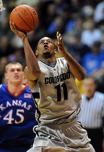 Cory Higgins gets past Cole Aldrich of KU to score. Cliff Grassmick / February 3, 2010