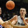 Cole Aldrich, left, and Xavier Henry, both of KU, try to get the ball from Shane Harris-Tunks of CU.<br /> Cliff Grassmick / February 3, 2010