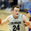Levi Knutson  of CU dribbles past Xavier Henry of Kansas.<br /> Cliff Grassmick / February 3, 2010