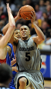 Marcus Relphorde of CU  gets the basket plus one against Kansas in the second half. Cliff Grassmick / February 3, 2010