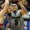 Marcus Relphorde of CU  gets the basket plus one against Kansas in the second half.<br /> Cliff Grassmick / February 3, 2010