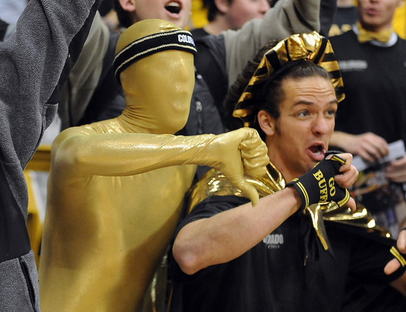 Gold Man and his sidekick, CU Pharaoh, made it to the CU- Kansas game.<br /> Cliff Grassmick / February 3, 2010