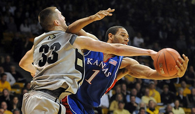 Austin Dufault of CU tries to knock a rebound away from Xavier Henry of Kansas. Cliff Grassmick / February 3, 2010