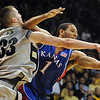 Austin Dufault of CU tries to knock a rebound away from Xavier Henry of Kansas.<br /> Cliff Grassmick / February 3, 2010