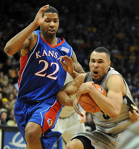 Marcus Relphorde of CU tries to hold on to the ball with Marcus Morris of KU defending. Cliff Grassmick / February 3, 2010