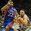 Marcus Relphorde of CU tries to hold on to the ball with Marcus Morris of KU defending.<br /> Cliff Grassmick / February 3, 2010