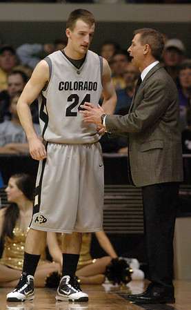 Levi Knutson of CU listens to coach Jeff Bzdelik during the Kansas game.<br /> Cliff Grassmick / February 3, 2010