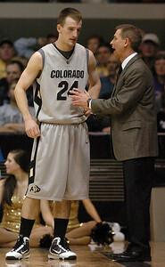 Levi Knutson of CU listens to coach Jeff Bzdelik during the Kansas game. Cliff Grassmick / February 3, 2010