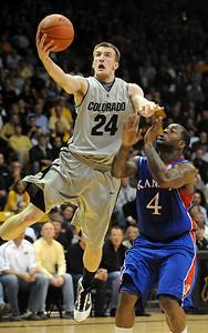 Levi Knutson of CU scores past Sherron Collins of KU. Cliff Grassmick / February 3, 2010