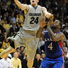 Levi Knutson of CU scores past Sherron Collins of KU.<br /> Cliff Grassmick / February 3, 2010