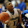 Cory Higgins of CU  tries to score past Brady Morningstar of KU<br /> Cliff Grassmick / February 3, 2010