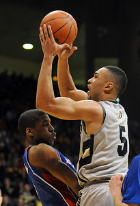 Marcus Relphorde of CU tries to draw a blocking foul against KU. Cliff Grassmick / February 3, 2010