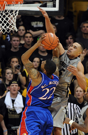 Marcus Relphorde of CU goes up strong to deny Marcus Morris of KU a lay up.<br /> Cliff Grassmick / February 3, 2010