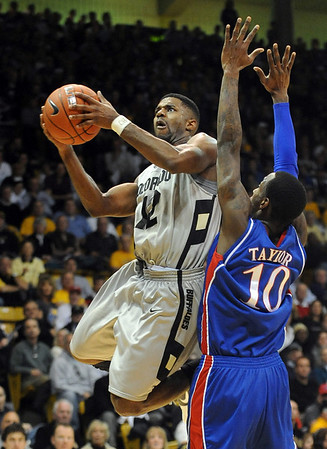 Dwight Thorne of CU gets past Tyshawn Taylor of KU.<br /> Cliff Grassmick / February 3, 2010