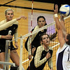 """Kerra Schroeder, left, Elysse Richardson and Alyssa Valentine, all of Colorado, watch the hit of Nikki Lindow against Kansas State.<br /> For more photos from the game, go to  <a href=""""http://www.dailycamera.com"""">http://www.dailycamera.com</a>.<br />  Cliff Grassmick / September 22, 2010"""