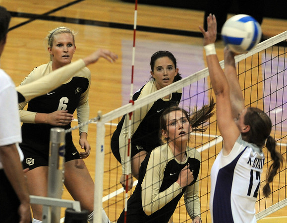 "Kerra Schroeder, left, Elysse Richardson and Alyssa Valentine, all of Colorado, watch the hit of Nikki Lindow against Kansas State.<br /> For more photos from the game, go to  <a href=""http://www.dailycamera.com"">http://www.dailycamera.com</a>.<br />  Cliff Grassmick / September 22, 2010"