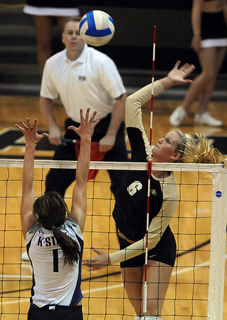 "Kerra Schroeder of Colorado hits past  Caitlyn Donahue  of K-State.<br /> For more photos from the game, go to  <a href=""http://www.dailycamera.com"">http://www.dailycamera.com</a>.<br />  Cliff Grassmick / September 22, 2010"