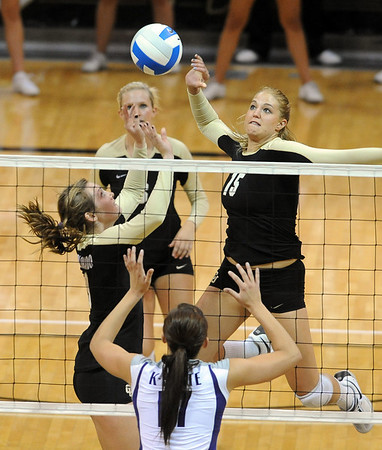 "Nikki Lindow of CU  hits a ball set by Alyssa Valentine, left, past Kaitlyn Pelger of KSU.<br /> For more photos from the game, go to  <a href=""http://www.dailycamera.com"">http://www.dailycamera.com</a>.<br />  Cliff Grassmick / September 22, 2010"