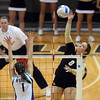 "Richi Bigelow of CU hits over Caitlyn Donahue of K-State.<br /> For more photos from the game, go to  <a href=""http://www.dailycamera.com"">http://www.dailycamera.com</a>.<br />  Cliff Grassmick / September 22, 2010"