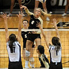 """Kerra Schroeder of Colorado hits past Kaitlyn Pelger (17) and Caitlyn Donahue  of K-State.<br /> For more photos from the game, go to  <a href=""""http://www.dailycamera.com"""">http://www.dailycamera.com</a>.<br />  Cliff Grassmick / September 22, 2010"""