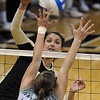 "Anicia Santos  of CU  hits against JuliAnne Chisholm of Kansas State on Wednesday.<br /> For more photos from the game, go to  <a href=""http://www.dailycamera.com"">http://www.dailycamera.com</a>.<br />  Cliff Grassmick / September 22, 2010"