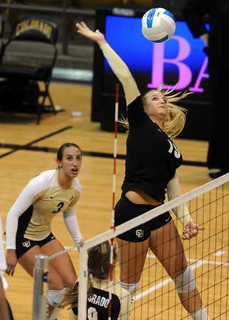 "Nikki Lindow of CU  hits against Kansas State on Wednesday.<br /> For more photos from the game, go to  <a href=""http://www.dailycamera.com"">http://www.dailycamera.com</a>.<br />  Cliff Grassmick / September 22, 2010"