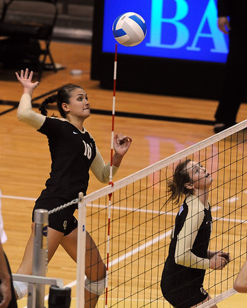 "Anicia Santos  of CU  hits against Kansas State on Wednesday.<br /> For more photos from the game, go to  <a href=""http://www.dailycamera.com"">http://www.dailycamera.com</a>.<br />  Cliff Grassmick / September 22, 2010"