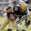 """Scotty McKnight takes a pass in for a touchdown against  Emmanuel Lamur of KSU.<br /> For more photos of the game, go to  <a href=""""http://www.dailycamera.com"""">http://www.dailycamera.com</a>.<br /> Cliff Grassmick / November 20, 2010"""