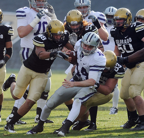 "Kansas State quarterback Carson Coffman, is surrounded by Liloa Nobriga (48), B.J.Beatty, and Will Pericak of Colorado, during the 44-36 win by Colorado on November 20, 2010 in Boulder<br /> For more photos of the game, go to  <a href=""http://www.dailycamera.com"">http://www.dailycamera.com</a>.<br /> Cliff Grassmick / November 20, 2010"