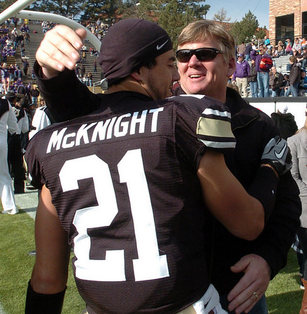 "Former coach Dan Hawkins has a hug for Scotty McKnight on CU senior day.<br /> For more photos of the game, go to  <a href=""http://www.dailycamera.com"">http://www.dailycamera.com</a>.<br /> Cliff Grassmick / November 20, 2010"
