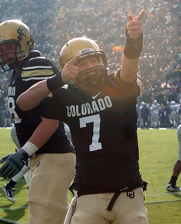 """Cody Hawkins points to his family in Dal Ward as teammates celebrate a Scotty McKnight TD.<br /> For more photos of the game, go to  <a href=""""http://www.dailycamera.com"""">http://www.dailycamera.com</a>.<br /> Cliff Grassmick / November 20, 2010"""