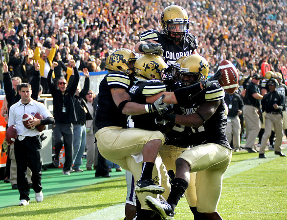 CU celebrates after wide receiver Scotty McKnight scores a touchdown during the game against Kansas State at Folsom Field on Saturday. CU beat Kansas State 44-36.<br /> Saturday, Nov.  20, 2010. <br /> SAM HALL / Camera