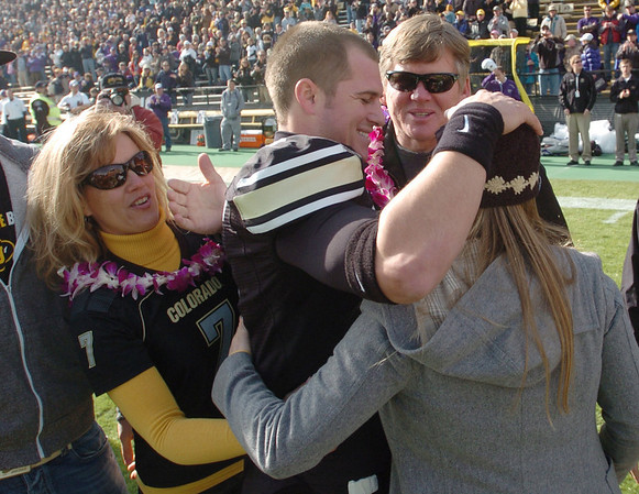 """CU QB Cody Hawkins is surrounded by his mother Misti, father, Dan, and sister, Brittany, during the senior day celebration at Folsom Field.<br /> For more photos of the game, go to  <a href=""""http://www.dailycamera.com"""">http://www.dailycamera.com</a>.<br /> Cliff Grassmick / November 20, 2010"""
